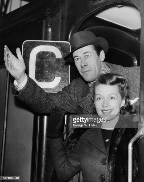 American actor Rex Harrison boards the 'Queen Elizabeth' boat train at Waterloo Station in London, with his wife, actress Lilli Palmer , 17th January...