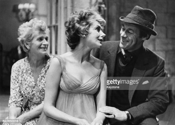 American actor Rex Harrison with his wife actress Kay Kendall and actress Gladys Cooper her costar in the play 'The Bright One' by Judy Campbell in...
