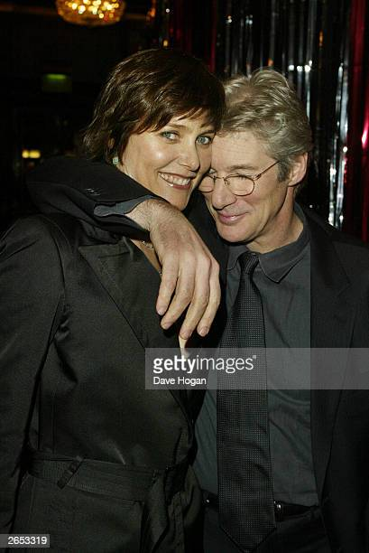 American actor Richard Gere and his wife attend the Chicago film party at the Cafe Royal on December 8 2002 in London