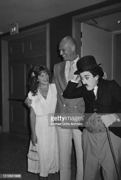 American actor Richard Moll with a Charlie Chaplin impersonator circa 1985