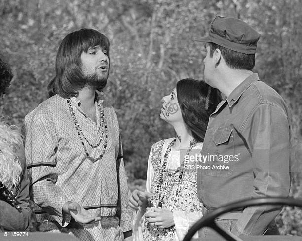American actor Rob Reiner gestures as he speaks with Leigh French and Jim Nabors in an episode of 'Gomer Pyle USMC' called 'Flower Power' California...