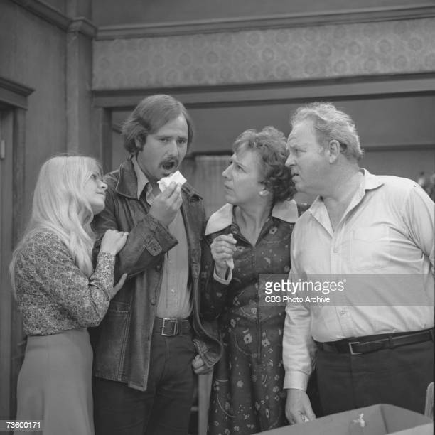 American actor Rob Reiner lifts a piece of cake to his mouth as fellow actors Sally Stuthers , Jean Stapleton and Carroll O'Connor , as Archie...