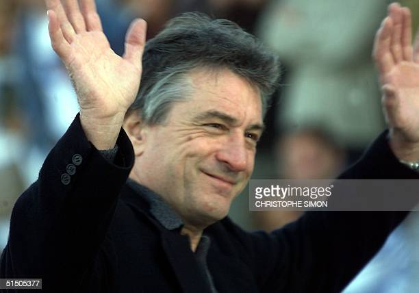 American actor Robert De Niro greets phtographers at the Palais du Kursaal arriving for the 48th annual San Sebastian film festival 29 September 2000