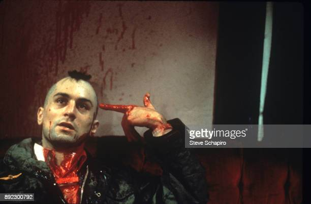 American actor Robert De Niro points a bloody finger at his own head in a scene from the film 'Taxi Driver' New York New York 1975