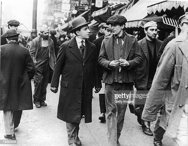 American actor Robert De Niro walking and talking with American actor Bruno Kirby in a still from the film 'The Godfather Part II' directed by...