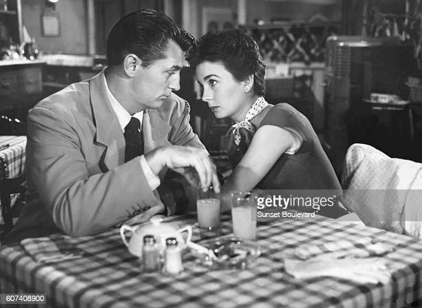 American actor Robert Mitchum and British actress Jean Simmons on the set of She Couldn't Say No directed by Lloyd Bacon