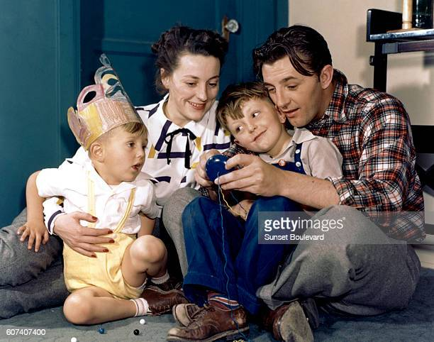 American actor Robert Mitchum and his wife Dorothy Spence and their two sons Christopher and James