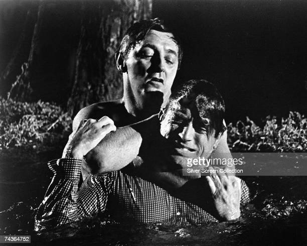 American actor Robert Mitchum as psychopath Max Cady and Gregory Peck as lawyer Sam Bowden in the thriller 'Cape Fear' directed by J Lee Thompson 1962