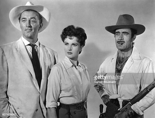 American actor Robert Mitchum German actress Ursula Thiess and Mexicanborn American actor Gilbert Roland on the set of Bandido directed by Richard...