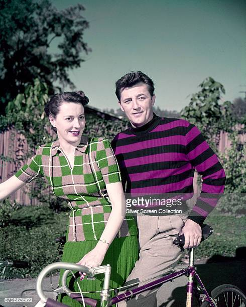American actor Robert Mitchum out cycling with his wife Dorothy circa 1955