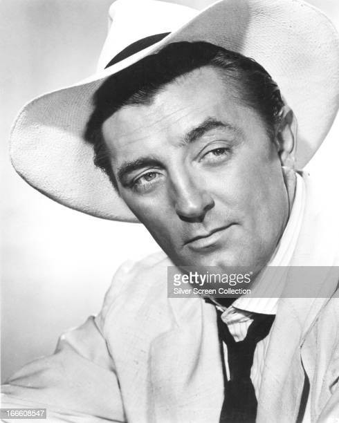 American actor Robert Mitchum wearing a widebrimmed fedora circa 1950