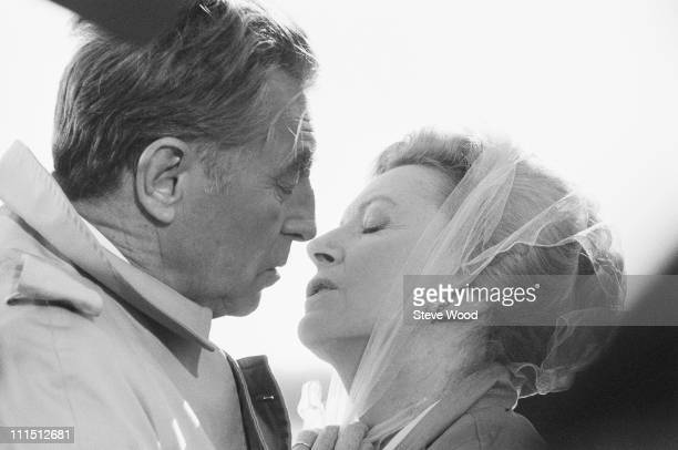 American actor Robert Mitchum with actress Deborah Kerr on the set of the television movie 'Reunion at Fairborough' UK 25th October 1984