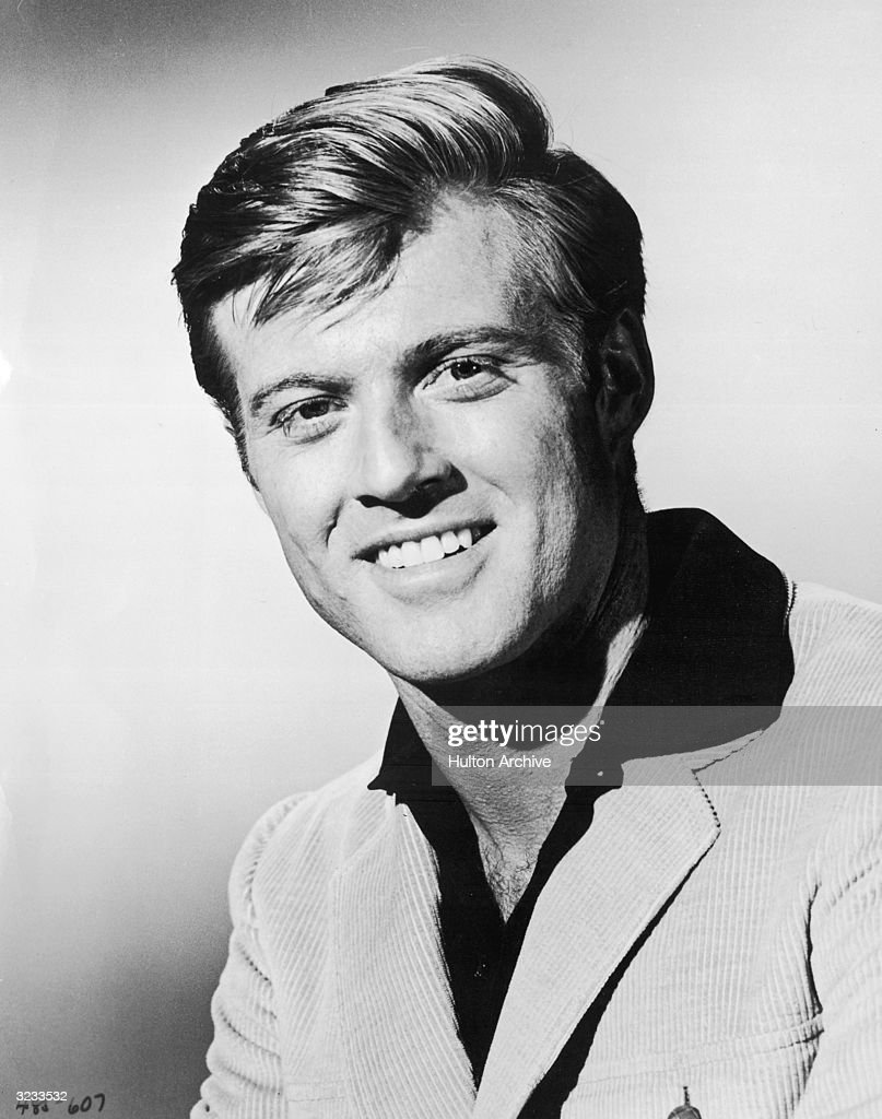 American actor Robert Redford smiles in a corduroy jacket in a promotional headshot portrait for the film, 'Inside Daisy Clover'.