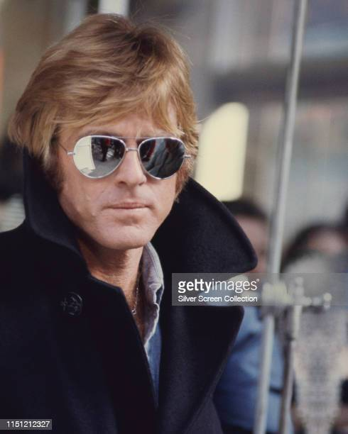 American actor Robert Redford wearing mirrored Ray-Ban aviator sunglasses in the film 'Three Days of the Condor', 1975.