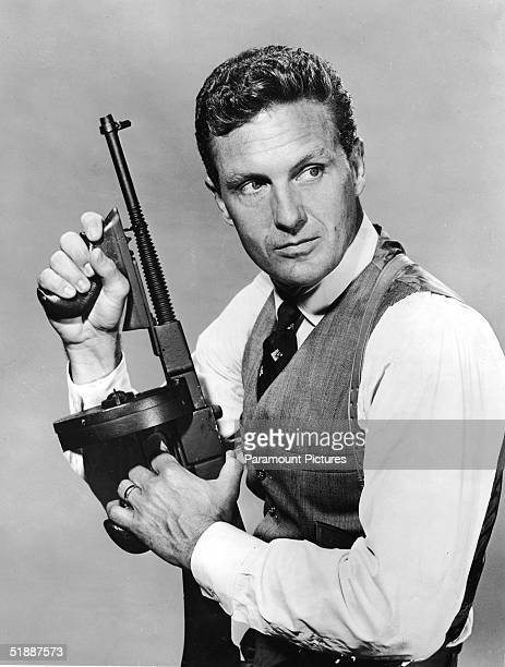 American actor Robert Stack as US treasury agent Eliot Ness holds a tommy gun in a publicity still for the television series 'The Untouchables' late...