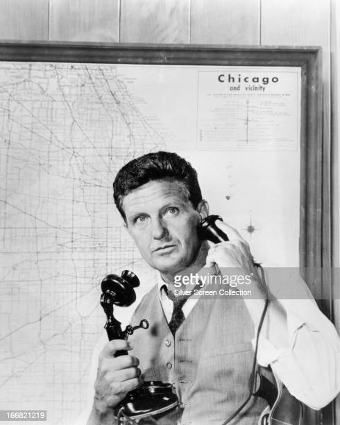 American actor Robert Stack using a candlestick telephone in the role of Eliot Ness in the TV crime series 'The Untouchables' circa 1960