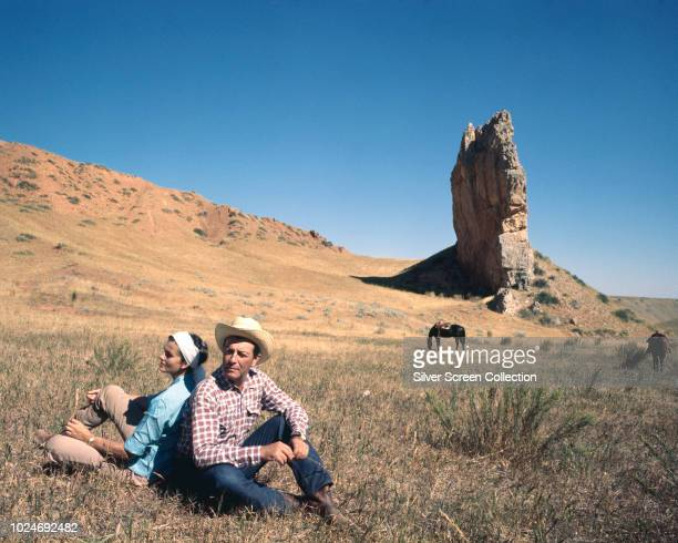 American actor Robert Taylor and his wife, actress Ursula Thiess on a ranch, circa 1960.