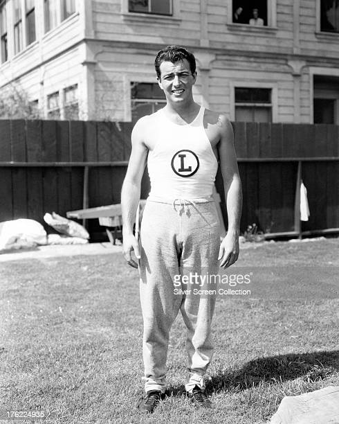 American actor Robert Taylor in track suit bottoms and a sports vest circa 1935
