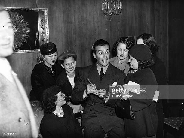 American actor Robert Taylor signing autographs in London Original Publication People Disc HP0261