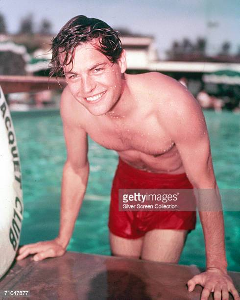 American actor Robert Wagner emerging from a swimming pool circa 1955