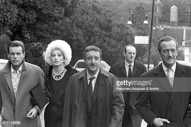 'American actor Robert Wagner French actress Capucine and British actors Peter Sellers and David Niven reaching the set of the film 'The Pink...