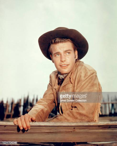 American actor Robert Wagner in western attire for his role in the film 'White Feather' 1955