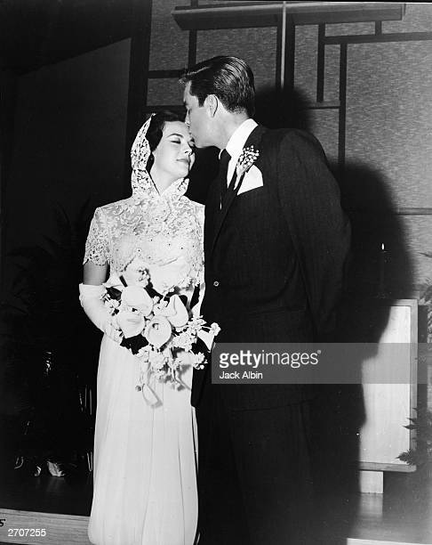 American actor Robert Wagner kisses the forehead of his bride American actress Natalie Wood at their wedding ceremony Scottsdale Arizona December 28...