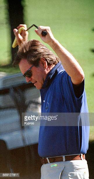 American actor Robert Wagner playing golf circa 1990