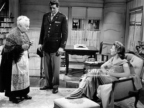 American actor Rock Hudson and German actress Cornell Borchers talking to Austrian actress Else Neft in the film Never Say Goodbye 1956