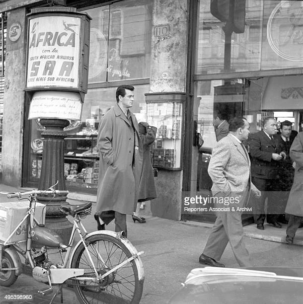 American actor Rock Hudson walking in the streets of the capital city while visiting Rome Rome 1956