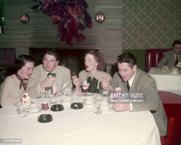 American actor Ronald Reagan and his second wife actress Nancy Davis eating ice cream sundaes with actors Eleanor Powell and her husband actor Glenn...