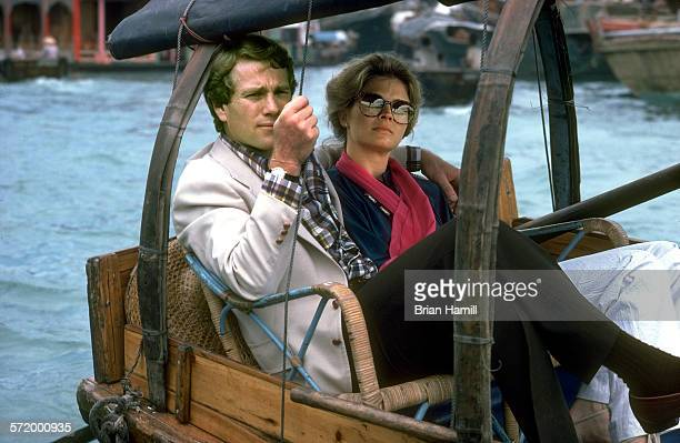 American actor Ryan O'Neal and an unidentified woman on a boat during the filming of 'Oliver's Story' New York 1978