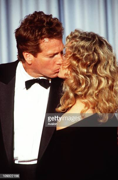 American Actor Ryan O'neal with girlfriend FARRAH FAWCETT at the 1989 Academy Awards