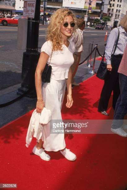 American actor Sarah Jessica Parker arrives at an event, circa 1992.