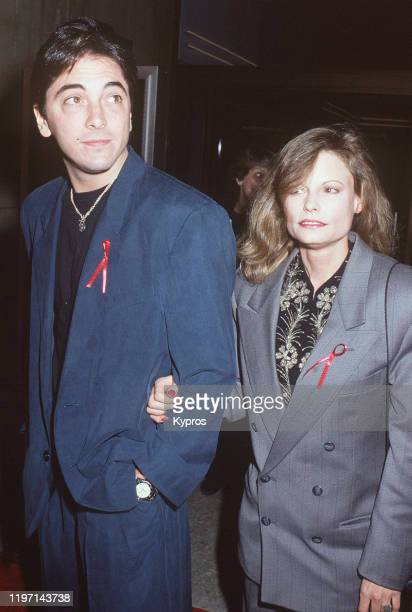 American actor Scott Baio and actress Kay Lenz wearing AIDS ribbons at the premiere of the film 'Falling From Grace' in Los Angeles California 19th...