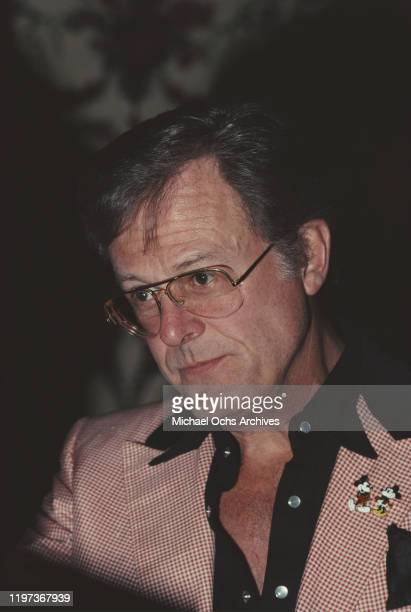 American actor screenwriter and director Robert Culp wearing a Walt Disney jacket with Mickey and Minnie Mouse on the lapel 1981