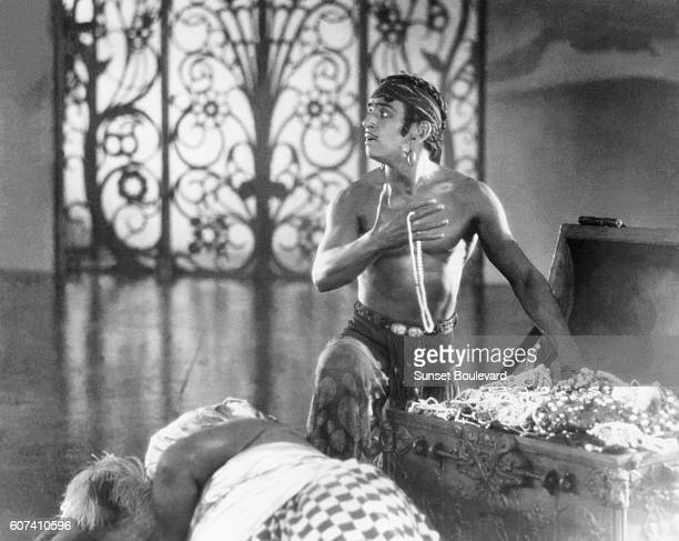 American actor, screenwriter and producer Douglas Fairbanks Sr. On the set of The Thief of Bagdad, directed by Raoul Walsh.