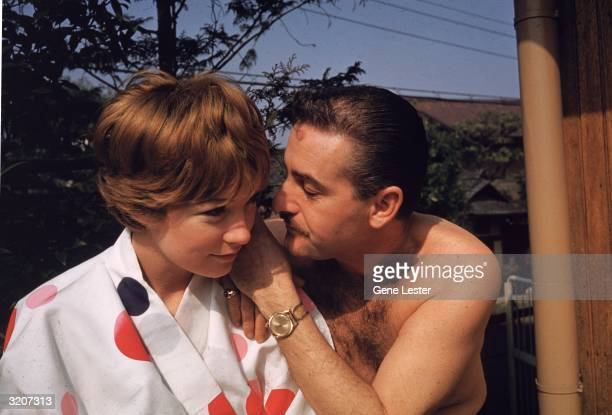 American actor Shirley MacLaine and her husband film producer Steve Parker nuzzle on the location set of director Jack Cardiff's film 'My Geisha' in...