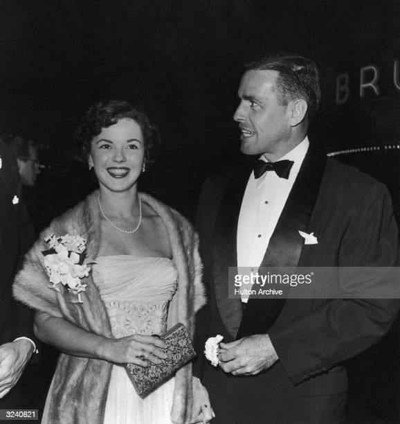 American actor Shirley Temple and her husband Charles Black pose together at the premiere of director William Wyler's film 'Roman Holiday' Temple...