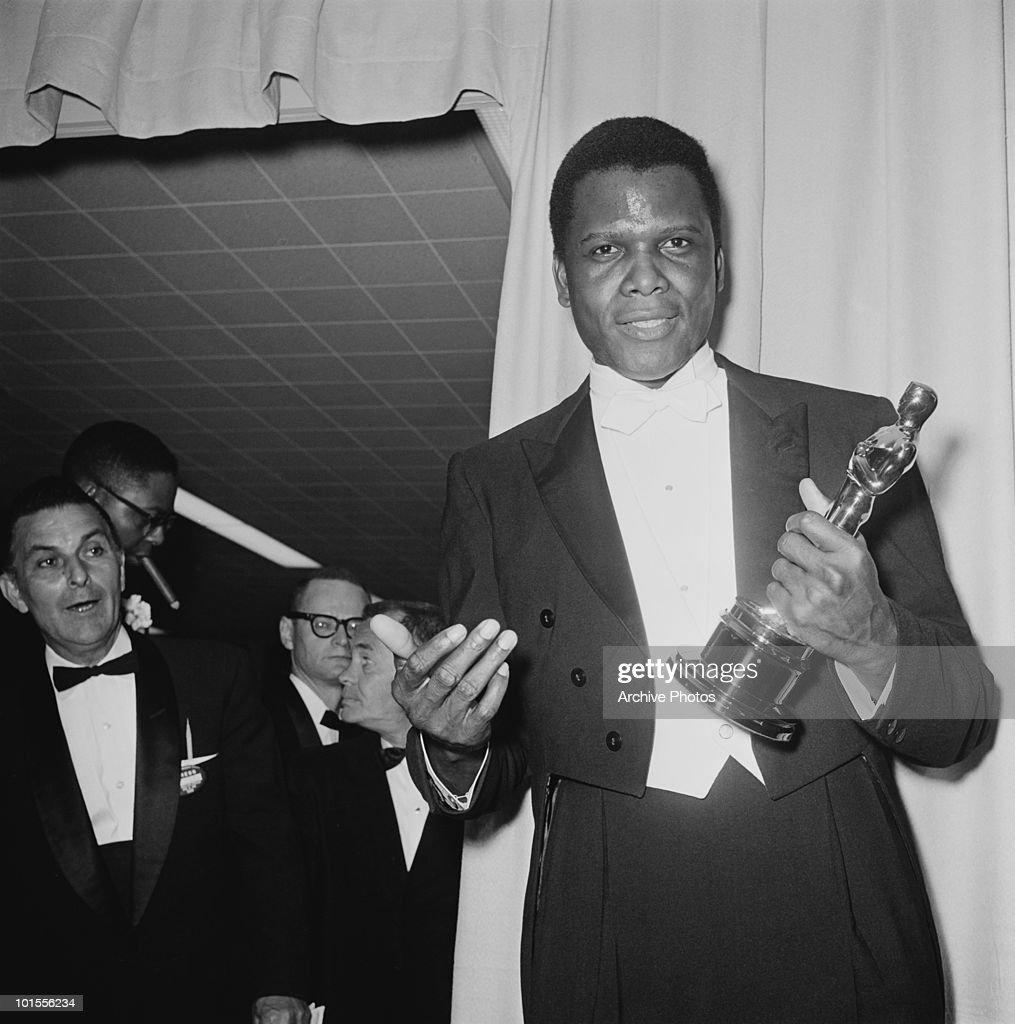 American actor Sidney Poitier with his Oscar after he won the Academy Award for Best Actor in a Leading Role, at the Beverly Hilton Hotel in Hollywood, California, 13th April 1964. Poitier won for his performance in 'Lilies Of The Field', directed by Ralph Nelson.