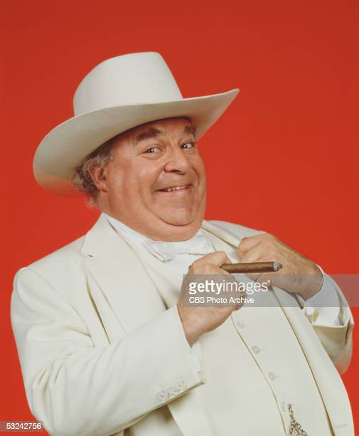 American actor Sorrell Booke holds a cigar and smirks as Jefferson Davis 'Boss' Hogg on the television series 'The Dukes of Hazzard' August 1982