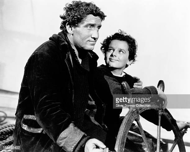 American actor Spencer Tracy as Manuel Fidello and EnglishAmerican child actor Freddie Bartholomew as Harvey Cheyne in 'Captains Courageous' directed...