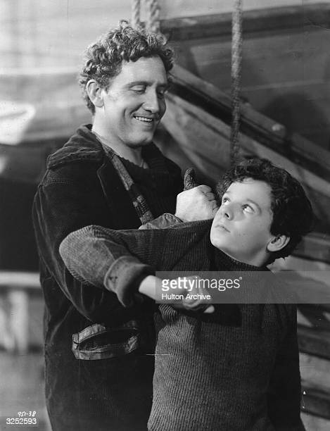 American actor Spencer Tracy gets a grip on child actor Freddie Bartholomew in a scene from the children's film 'Captains Courageous' directed by...