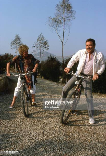 American Actor Stacy Keach rides his bike with his third wife 3 Jill Donahue along drive of their California home circa 1984