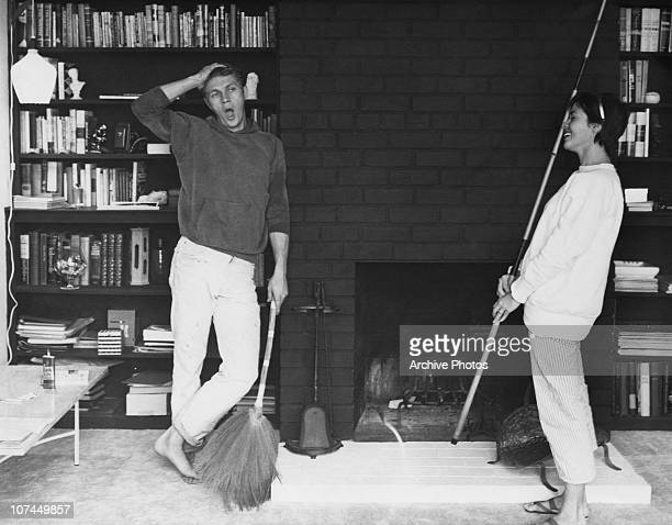 American actor Steve McQueen and his first wife actress Neile Adams carry out some household chores circa 1958