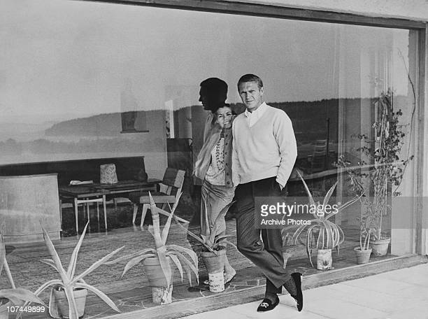 American actor Steve McQueen and his first wife, actress Neile Adams, separated by a windowpane, circa 1965.