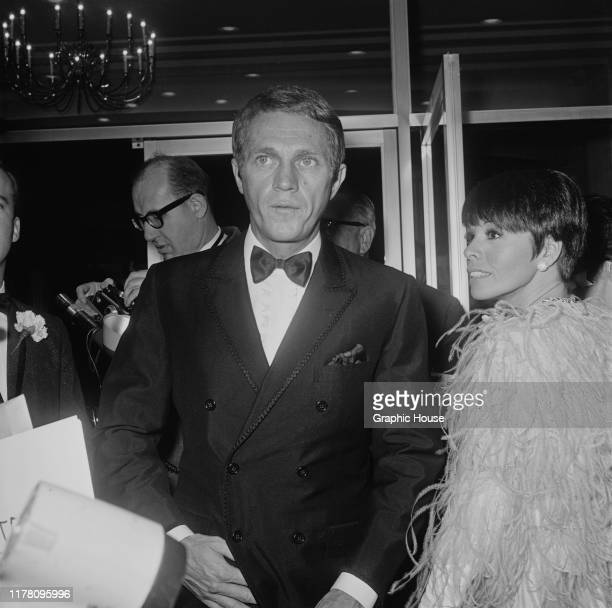 American actor Steve McQueen and his wife actress Neile Adams at the premiere of the film 'The Sand Pebbles' 1966 McQueen stars in the film