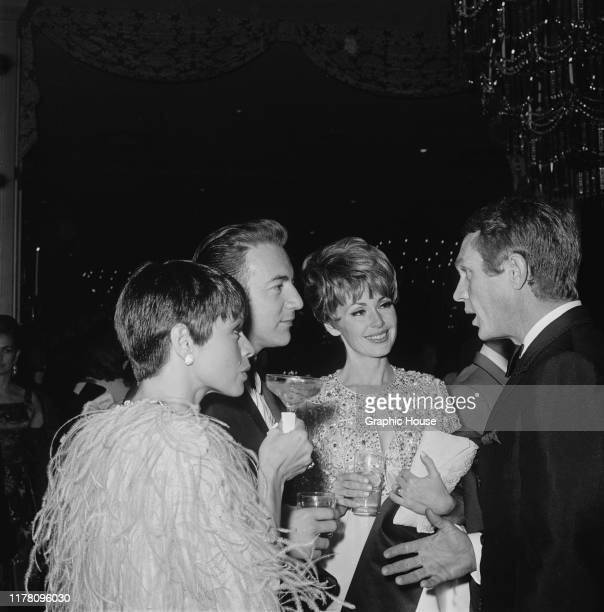 American actor Steve McQueen and his wife, actress Neile Adams talking to singer Bobby Darin and actress Barbara Rush at the premiere after-party for...
