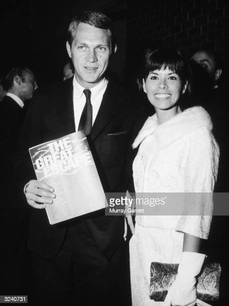 American actor Steve McQueen and his wife American actor Neile Adams attend the premiere of director John Sturges' film 'The Great Escape' in which...