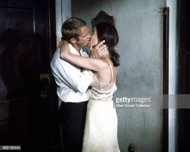 American actor Steve McQueen as Doc McCoy and American actress Ali MacGraw as Carol McCoy on the set of The Getaway, directed by Sam Peckinpah, 1972.